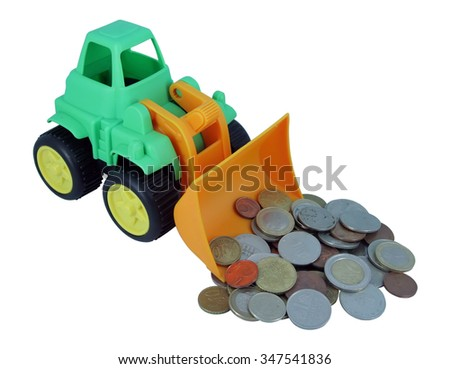 Bulldozer toy and coins. Kids bulldozer toy collecting various coins. - stock photo