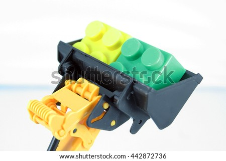 Bulldozer toy with cubes. - stock photo