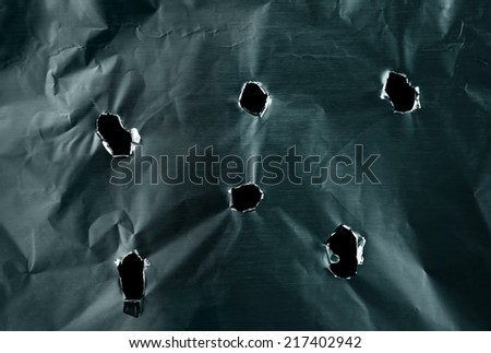 Bullet holes in metal textured background                                 - stock photo