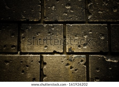 Bullet holes in the brick wall  - stock photo