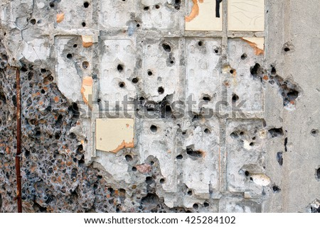 bullet holes in the wall - stock photo