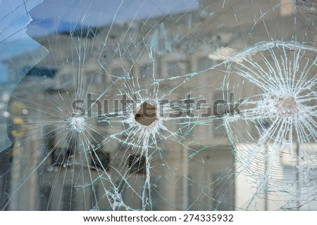 Bullet holes in the window of a shop in Dnepropetrovsk. - stock photo