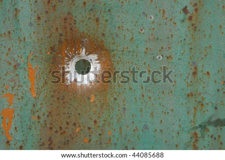 bullet in a metal - stock photo