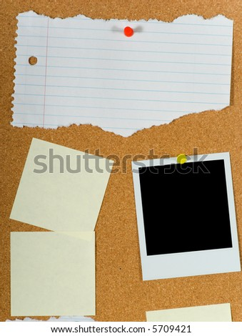 Bulletin board with assorted  blank items including post-it notes a torn sheet of paper and a blank instant transfer image or instant photo - stock photo