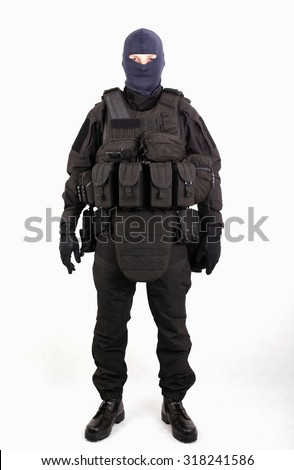 Bulletproof vest, masked man dressed in black military gear on white background