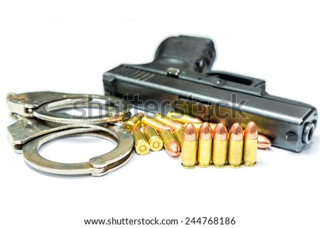 Bullets and Gun on white background with handcuffs - stock photo