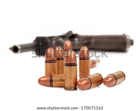 bullets and pistol on white background