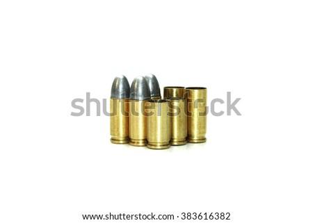 Bullets and shells pistol handgun isolated on white background - stock photo