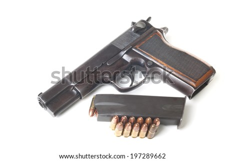 Bullets, armed holder and gun isolated on white background - stock photo