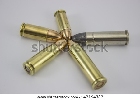 Bullets lined up to form a powerful star - stock photo