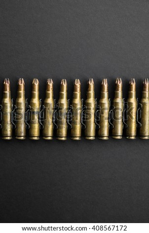 Bullets on black background - stock photo