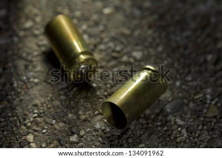 Bullets on ground - stock photo