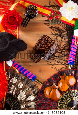 Bullfighter and flamenco typical from Espana Spain torero hat castanets comb flag and rose - stock photo