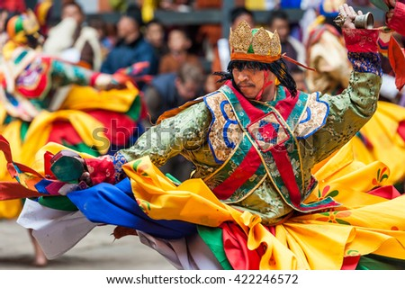 Bumthang, Bhutan, 06 Nov 2011: A performer spins while holding his ceremonial hand bell at the Jakar Festival at Jakar Dzong. - stock photo