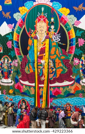 Bumthang, Bhutan, 06 Nov 2011: Locals offering prayers to thangka scroll painting at the tsechu festival at Jakar Dzong.
