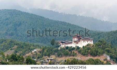 Bumthang, Bhutan, 05 Nov 2011: View of Jakar Dzong with mountain range background. - stock photo