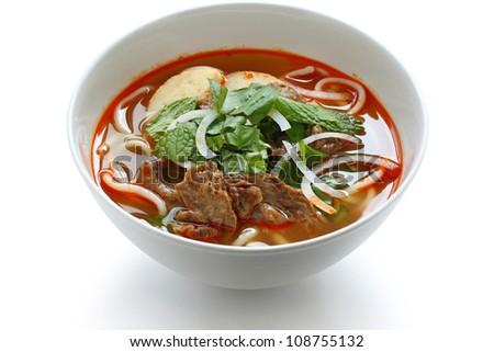 bun bo hue, a bowl of beef & rice vermicelli soup, vietnamese noodle cuisine - stock photo
