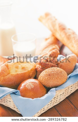 bun,bread and croissant in basket for breakfast with color effect - stock photo