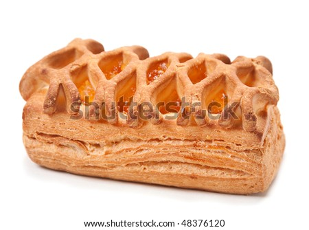 Bun puff pastry with apricot jam on white
