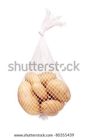 bunch fresh potatoes in a white mesh bag - stock photo