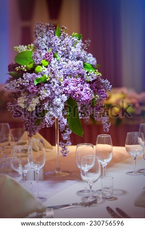 bunch lilac in vase on table - stock photo