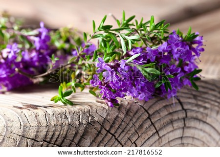 Bunch of a blossoming thyme on an old wooden table