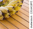 Bunch of banana on wooden table - stock photo