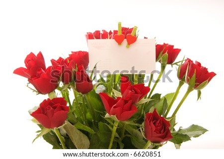 bunch of beautiful red roses with blank ticket isolated on white