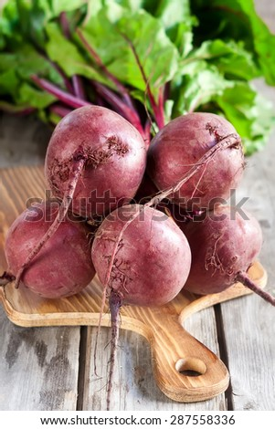Bunch of beetroots on old wood background