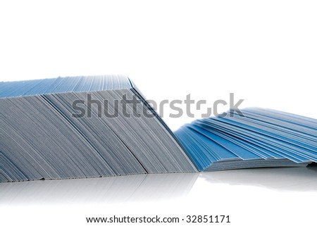Bunch of blue business cards, isolated on white background, with shadow
