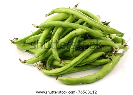 bunch of broad beans on a white background - stock photo