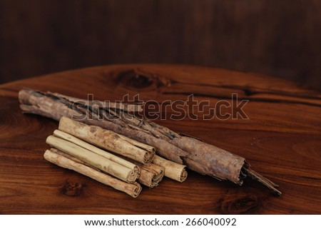 Bunch of cinnamon sticks on wooden background
