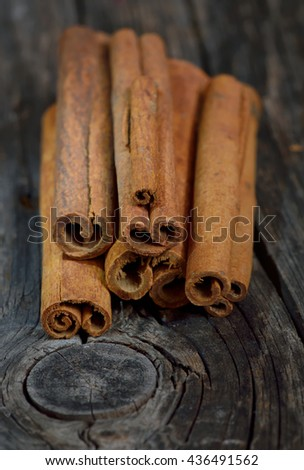 Bunch of cinnamon sticks on wooden table