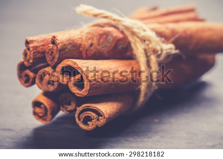 Bunch of cinnamon sticks. vintage photo - stock photo