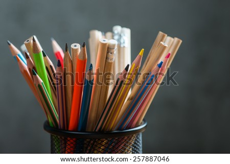 Bunch of color pencils in a stand - stock photo