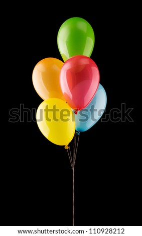 Bunch of colorful balloons isolated on black - stock photo
