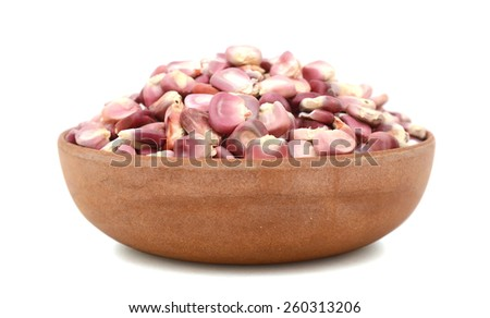bunch of corn seed in bowl isolated on white  - stock photo