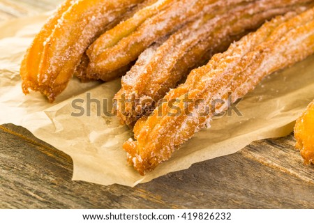 Bunch of curros covered with granulated sugar.
