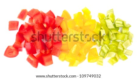 bunch of cut pieces of paprika on a wood background - stock photo