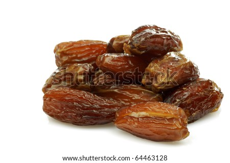 bunch of date fruit on a white background