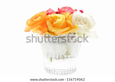 bunch of different roses in a glass vase isolated on white - stock photo