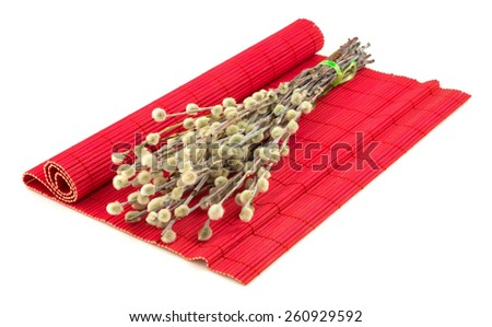 Bunch of easter willow on red mat isolated on white background