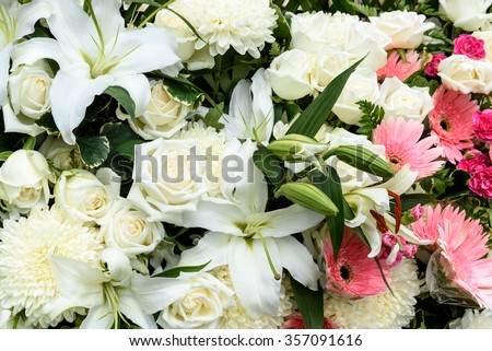 Bunch of flowers, bouquet of flowers including white roses, white chrysanthemums, white lilies, pink gerberas and violet carnations (dianthus caryophyllus).