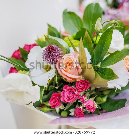 Bunch of flowers  gift. Coloful background.