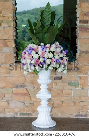 Bunch of flowers in a big decorative vase - stock photo