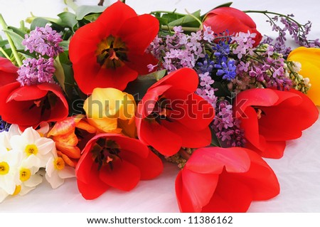 bunch of flowers, tulips, lilac, narcissus - stock photo