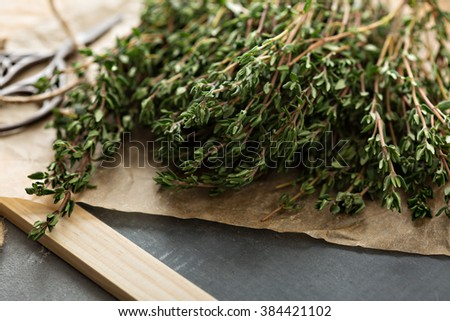 Bunch of fresh aromatic thyme on the table - stock photo