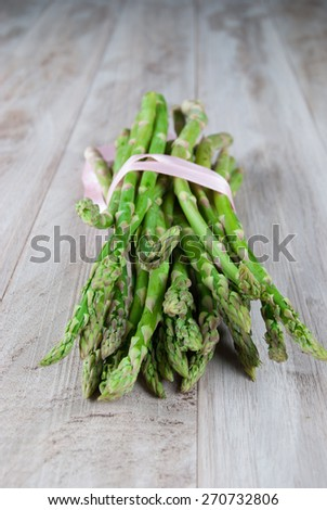 Bunch of Fresh Asparagus on Wooden Background - stock photo