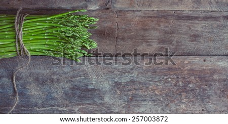 Bunch of fresh asparagus on wooden table. Healthy food photo series.  - stock photo