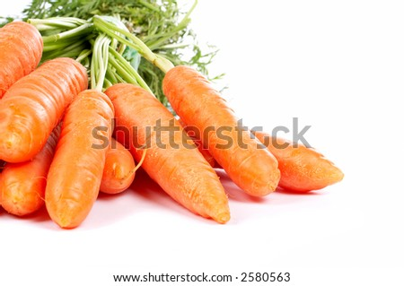Bunch of fresh carrots with shadow on white background - stock photo